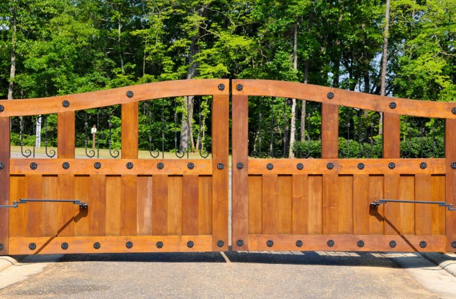 Decorative driveway gate for a home